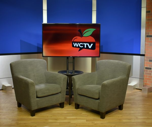 Back and aluminum set background with two chairs for casual interview style news broadcast productions