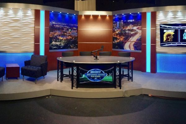 Tv set design with Led lights and a news interview desk in the front