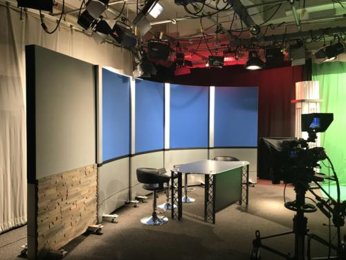 Access Sacramento Rolling Panel System - 4' RP (4) with chroma key blue upper panels and chemetal brushed aluminum  knee walls & columns and 1 upper grey veltex and lower faux stone