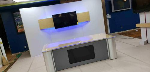 Custom news interview desk with acrylic top and LED integrated lights  and customer set background for broadcasting studio