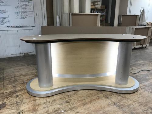 Custom news interview desk backlit with LED lights for broadcast studio productions