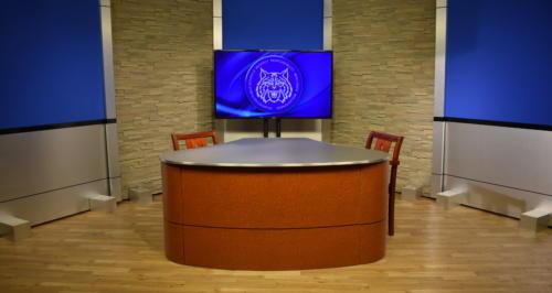 tv studio set design for news desk background with stone