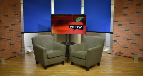 tv studio set design for news desk background with brick