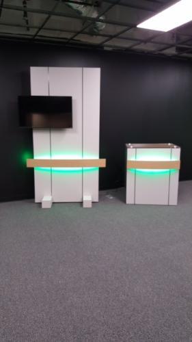 custom news anchor podium and tv wall with led lights