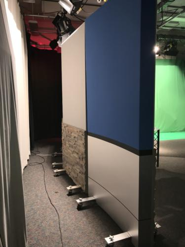 Access Sacramento Rolling Panel System 1 panel chroma key blue upper panels and chemetal brushed aluminum  knee walls & columns and 1 upper grey veltex and lower faux stone