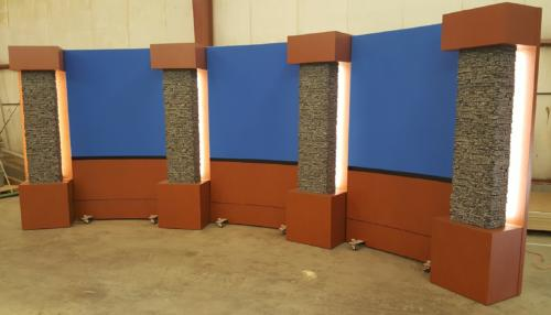 5' Rolling Panels with Chroma Blue Upper Veltex and cognac birdseye lower knee walls with stone LED columns