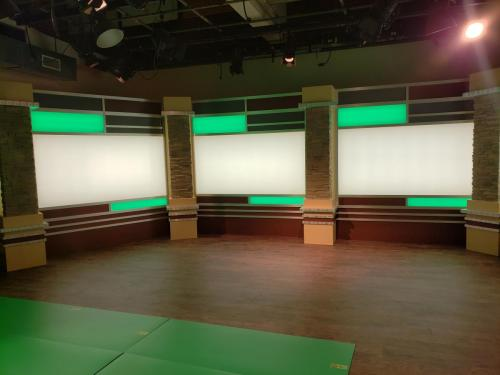 tv news set design background for broadcast productions with led lights and faux stone columns