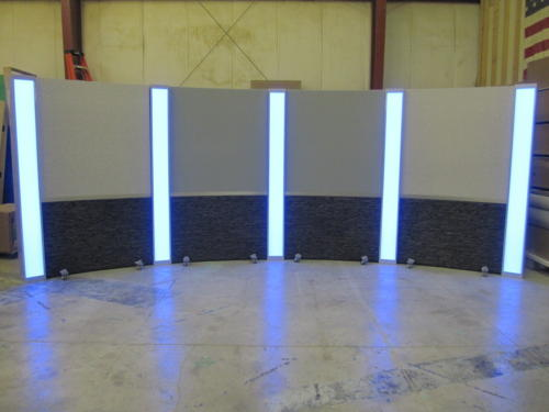 dark grey faux stone lower and grey upper veltex rolling panels with light box columns