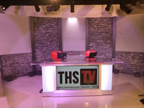 tv studio set design with brick background